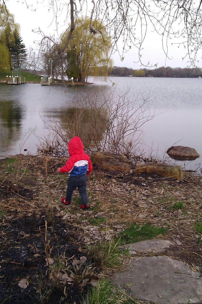 Soren learned the fine art of throwing rocks in the water.