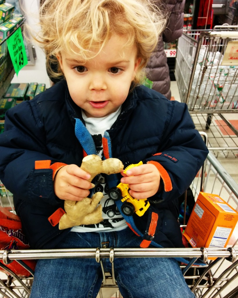 Soren occupies himself with a loader and fresh ginger to get through the craziness of a pre-Thanksgiving Market Basket run.