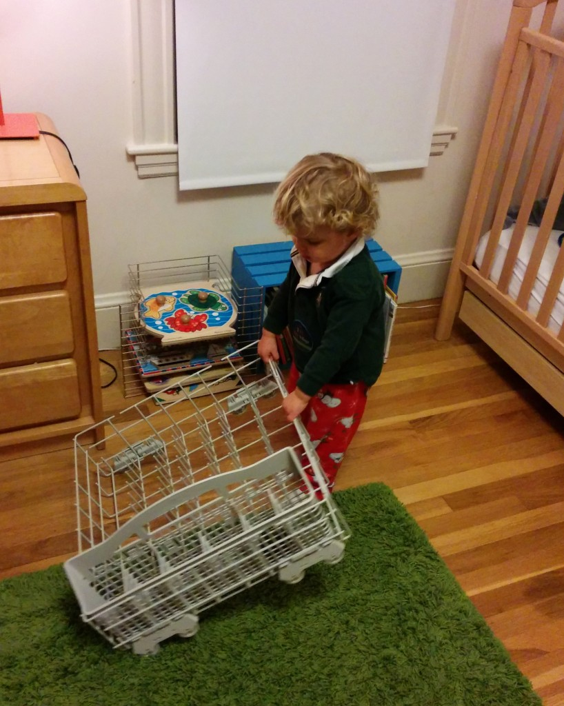 One afternoon Soren took emptying the dishwasher into his own hands. Anything with wheels is Soren's favorite thing.