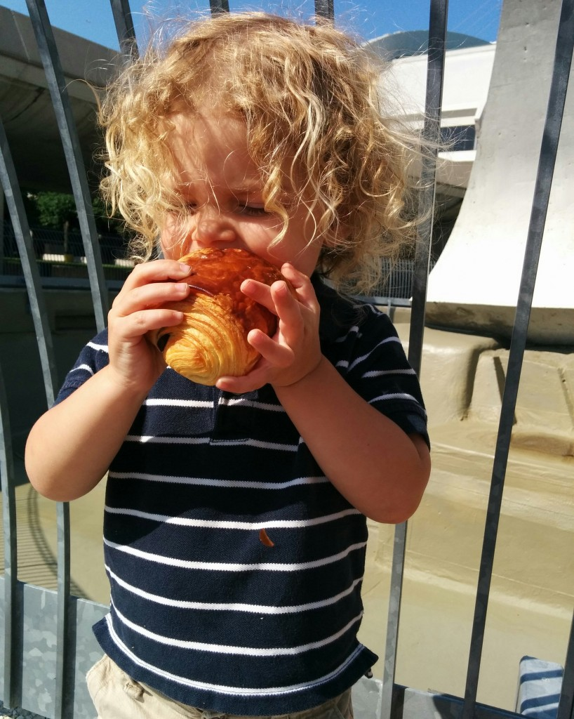 Look at this face! He knows about the important things in life — pain au chocolat.