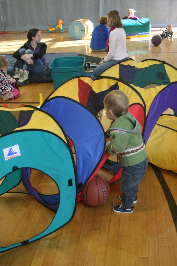 10:56 a.m. Soren loves to crawl through the tents and tunnels, and it's extra fun to bring a basketball along.