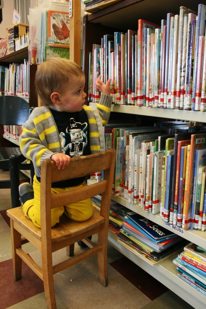 11:07 a.m. Soren's preferred book-choosing position. We've mostly mastered the no-standing-on-the-chairs idea.
