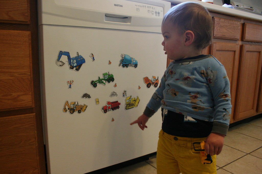 3:28 p.m. After nap time we had a little fun with truck magnets. Soren is still trying to figure out where the magnets will stick, but I think he's finally realized they won't stick to my clothes, despite his best efforts.