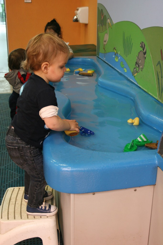 The Como Park Zoo has a really fun children's gallery with lots of hands-on activities. Soren is never one to turn down a place to splash.
